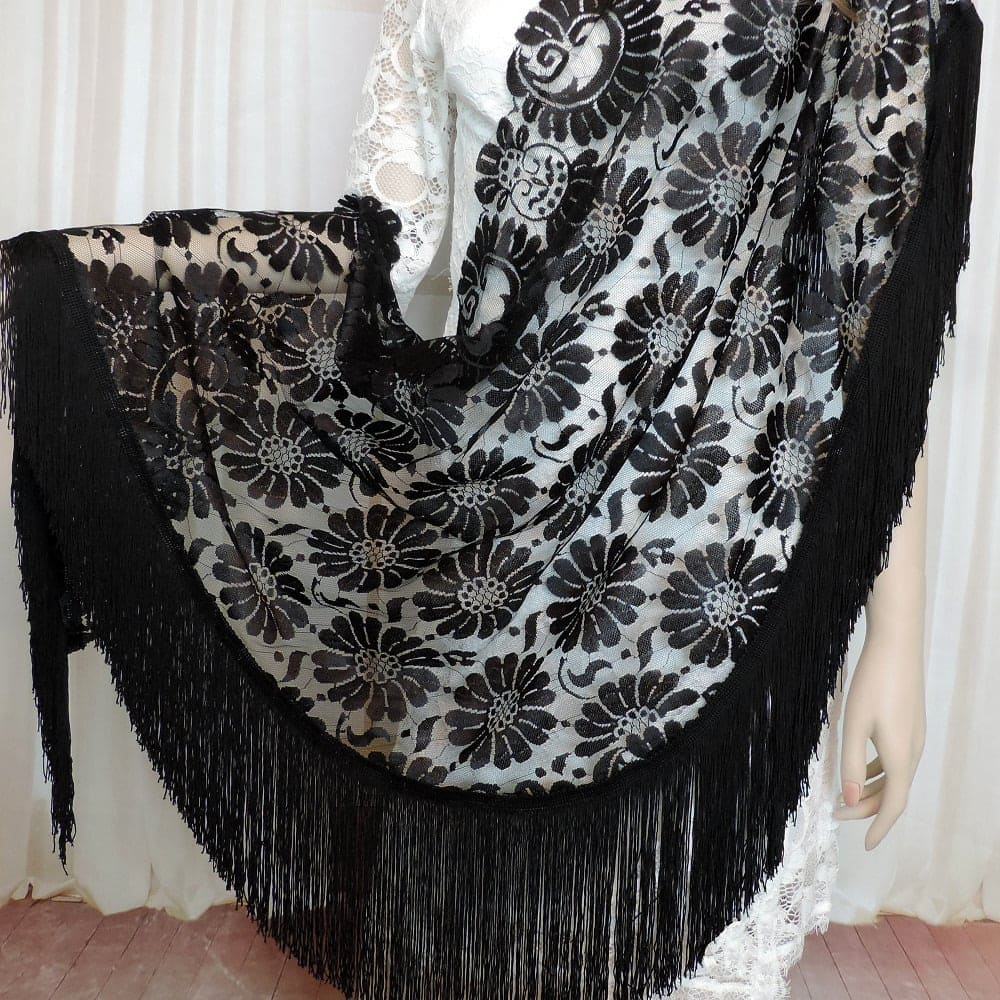 Lace shawl with fringe